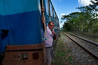 HAVANA, CUBA - FEBRUARY 8: A Cuban man smokes as he travels on a train during the trip from Havana to San Antonio de los Baños on February 8, 2018 in Cuba. Ferrocarriles de Cuba, is one of the oldest railroad around world, having opened its first route in 1837 with at least 17-mile long. Now the railway probably could cover more than 2,600 miles along the Island. (Photo by Eliana Aponte/VIEWpress)