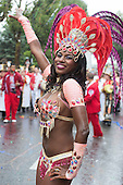 London, England. 31 August 2015. Performers from the Paraiso School of Samba on parade. Performers and revellers were in good spirits despite a second years of heavy rain on the Adult Day of Notting Hill Carnival. Photo: Bettina Strenske