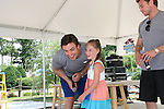 Anna Kaplan gets to go on stage at Joyce Becker's Soap Opera Festivals present Young and Restless' Daniel Goddard and Billy Miller at Six Flags Hurricane Harbor on July 26, 2009 in Jackson, New Jersey. (Photo by Sue Coflin/Max Photos)