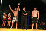 Jake Morris points to the crowd after defeating his opponent by breaking his jaw seconds before the first round ended.