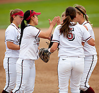STANFORD, CA - April 2, 2011: The Stanford softball team meets at the mound during Stanford's game against Arizona at Smith Family Stadium. Stanford lost 6-1.