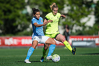 Seattle, WA - Sunday, April 17, 2016: Sky Blue FC midfielder Raquel Rodriguez (11) works to maintain possession against Seattle Reign FC forward Beverly Yanez (17). Sky Blue FC defeated the Seattle Reign FC 2-1 during a National Women's Soccer League (NWSL) match at Memorial Stadium.