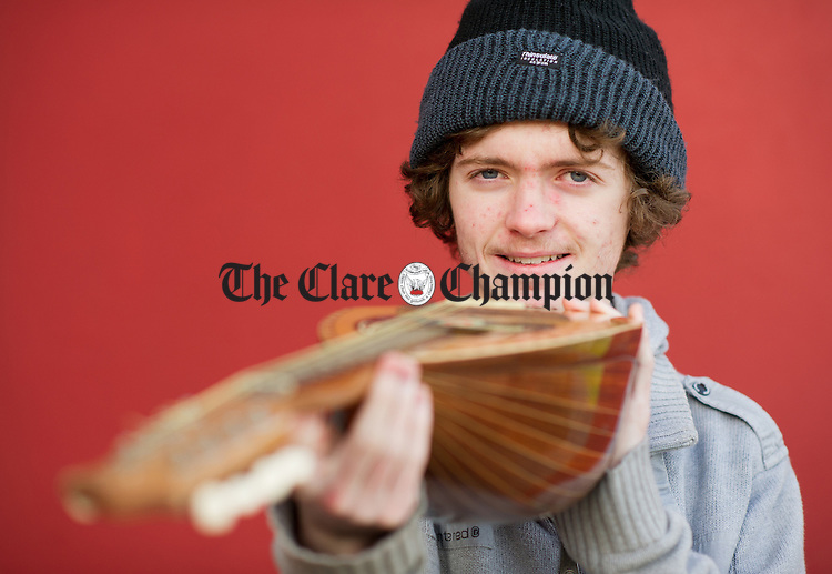 """John Clancy of Mary Immaculate Secondary School, Lisdoonvarna, whose project is entitled """"A look at five factors that influence the sound quality of a mandolin."""" . Photograph by John Kelly."""