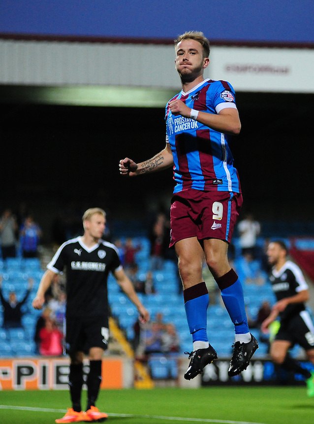 Scunthorpe United's Paddy Madden celebrates scoring his sides equalising goal from the penalty spot to make the score 1-1<br /> <br /> Photographer Chris Vaughan/CameraSport<br /> <br /> Football - Capital One Cup First Round - Scunthorpe United v Barnsley - Tuesday 11th August 2015 - Glanford Park - Scunthorpe<br />  <br /> &copy; CameraSport - 43 Linden Ave. Countesthorpe. Leicester. England. LE8 5PG - Tel: +44 (0) 116 277 4147 - admin@camerasport.com - www.camerasport.com