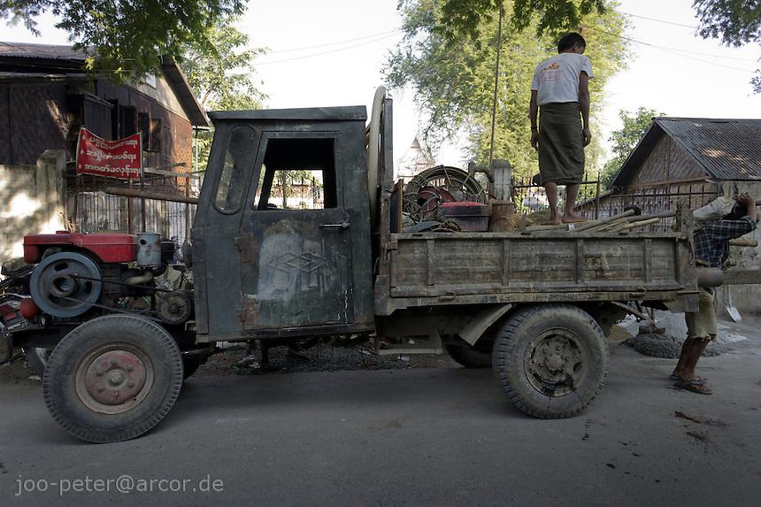 typical burmese bare-bone car in Mandalay, Myanmar, 2011