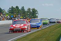 6-8 August, 2010, Watkins Glen, New York USA.Juan Pablo Montoya (#42) leads..©2010 F.Peirce Williams, USA.