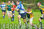 Tralee Rugby player No 7 ? gets away from Listowel's John Healy in the local derby clash at Listowel on Sunday last.
