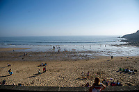 WEATHER PICTURE WALES<br /> People on the beach during the unusually warm weather in Langland Bay near Swansea, Wales, UK. Wednesday 27 February 2019