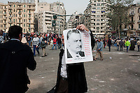 A protester in Tahrir Square holds up a poster of former president Gamal Abdel Nasser. Continued anti-government protests take place in Cairo calling for President Mubarak to stand down. After dissolving the government, Mubarak still refuses to step down from power. .