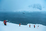 Hikiing to the lookout at the top of a hill at Orne Harbour, Antarctica