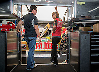 "Oct 15, 2016; Ennis, TX, USA; ""Papa John"", founder, chairman and CEO of Papa John's International John Schnatter (left) and NHRA top fuel driver Leah Pritchett strategize in the pits during qualifying for the Fall Nationals at Texas Motorplex. Mandatory Credit: Mark J. Rebilas-USA TODAY Sports"