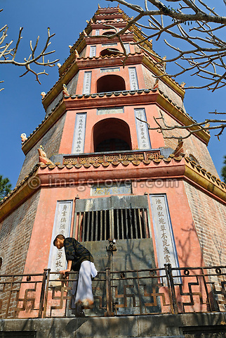 Asia, Vietnam, Hue. Thap Phuoc Duyen (Source of Happiness Tower) at Thien Mu (Heavenly Lady Pagoda). Designated a UNESCO World Heritage Site in 1993, Hue is honoured for its complex of historic monuments. Overlooking the river Huong (Perfume River) and set amidst verdant greenery, the Thien Mu Pagoda is the oldest pagoda in Hue. Built in 1601 the 21meter high seven-story octogonal tower Thap Phuoc Duyen is now the official symbol of the city Hue.