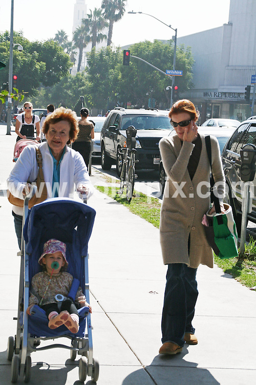 **ALL ROUND EXCLUSIVE PICTURES FROM SOLARPIX.COM**.**WORLDWIDE SYNDICATION RIGHTS EXCEPT FOR USA, AUSTRALIA & GERMANY**.The American actress Marcia Cross walks the streets of Santa Monica in Beverly Hills with her daughter and mother while wearing a bright green peace sign hand bag...JOB REF:7659-LAS/MD       DATE:21_10_08.**MUST CREDIT SOLARPIX.COM OR DOUBLE FEE WILL BE CHARGED* *UNDER NO CIRCUMSTANCES IS THIS IMAGE TO BE REPRODUCED FOR ANY ONLINE EDITION WITHOUT PRIOR PERMISSION*