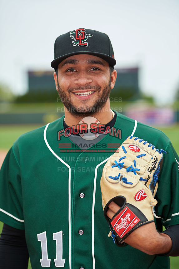 Great Lakes Loons pitcher Jordan Sheffield (11) poses for a photo after a game against the Burlington Bees on May 4, 2017 at Dow Diamond in Midland, Michigan.  Great Lakes defeated Burlington 2-1.  (Mike Janes/Four Seam Images)