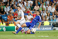 Gareth Bale of Real Madrid and Suchy of FC Basel 1893 during the Champions League group B soccer match between Real Madrid and FC Basel 1893 at Santiago Bernabeu Stadium in Madrid, Spain. September 16, 2014. (ALTERPHOTOS/Caro Marin) /NortePhoto.com
