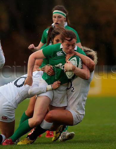 13.11.2016. UCD Bowl, Dublin, Ireland. November Series. Ireland Women versus England.<br /> Emily Scott (England) and Rachael Burford (England) tackle Niamh Kavanagh (Ireland).