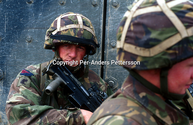 British KFOR soldiers outside their armoured veichle on May 10, 1999 outside Skopje, Macedonia. A training exercise was done before they entered Kosovo in the beginning of June 1999. .(Photo: Per-Anders Pettersson/ Getty Images)