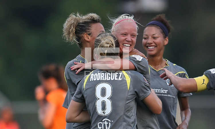 Philadelphia's Caroline Seger congratulates teammate Amy Rodriguez on her goal, the second for Philly.  The Philadelphia Independence scored three first half goals, and went on to win 4-1 over Sky Blue at John A Farrell Stadium in West Chester, Pennsylvania.