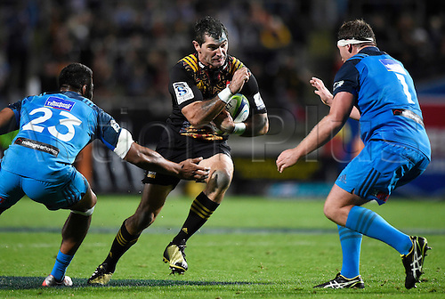 08.04.2016. Hamilton, New Zealand.  Stephen Donald runs into cover during the Blues versus Chiefs Super Rugby match at Waikato Stadium, Hamilton, New Zealand. Friday 8 April 2016.