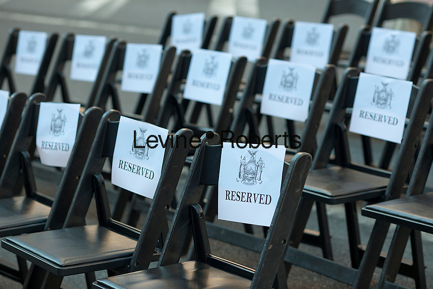 """Seats reserved for dignitaries at the Brooklyn Battery Tunnel in New York prior to the renaming ceremony for the  Hugh L. Carey Tunnel on Monday, October 22, 2012 after the late NYS Governor Carey who served from 1975 to 1982. Carey was responsible for seeing New York City out its fiscal crisis in the 70's as well as starting the iconic """"I (heart) New York"""" promotional program. Carey died in 2011 at the age of 92. (© Richard B. Levine)"""