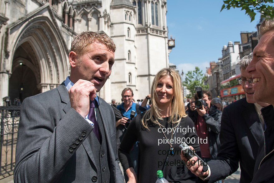 Pic shows: Jonathan Platt  centre - outside the High Court in London today after winning his case again Isle of Wight council<br /> <br /> He left with fiancee Sally Barclay - blonde woman<br /> <br /> <br /> <br /> Pic by Gavin Rodgers/Pixel 8000 Ltd