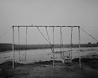 A playground in a camp along the river Ravi where a community from Shie Kho Pura settled to primarily raise water buffalos, in the outskirts of Lahore, Pakistan on Tuesday November 17, 2009..The owner charges pennies for a ride.