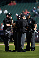 The umpiring crew gets together to discuss a call during the NCAA baseball game between the Missouri Tigers and the Baylor Bears in game one of the 2020 Shriners Hospitals for Children College Classic at Minute Maid Park on February 28, 2020 in Houston, Texas. The Bears defeated the Tigers 4-2. (Brian Westerholt/Four Seam Images)