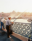 TURKEY, Istanbul, senior men fishing at Galata bridge