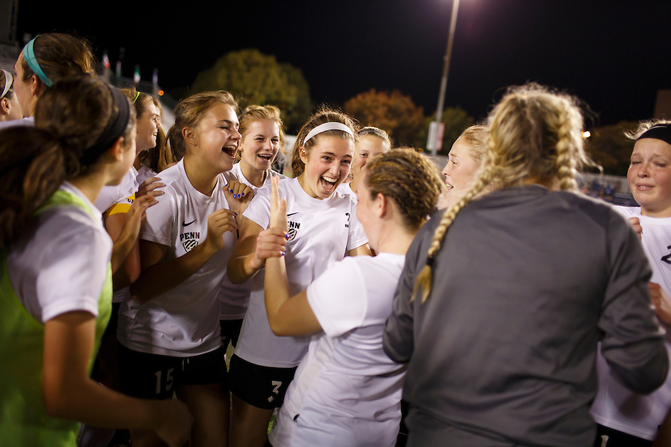 Penn's Erin Ludwig, center, celebrates a 2-0 win against Brebeuf Jesuit with her teammates after the IHSAA Class 2A Girls Soccer State Championship Game on Saturday, Oct. 29, 2016, at Carroll Stadium in Indianapolis. Special to the Tribune/JAMES BROSHER