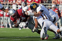 Sean Cattouse (center) and Eric Stevens (right) combine on the tackl against Logwone Mitz. The University of California football defeated Washington State University 20-13 at Martin Stadium in Pullman, Washington on November 6th, 2010.