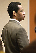 Convicted sniper John Allen Muhammad stands as the jury recommendation of death is read in courtroom 10 at the Virginia Beach Circuit Court in Virginia Beach, Virginia on Monday November 24, 2003.  <br /> Credit: Davis Turner - Pool via CNP
