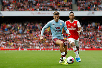 Jack Grealish of Aston Villa with Pierre-Emerick Aubameyang of Arsenal close by during the Premier League match between Arsenal and Aston Villa at the Emirates Stadium, London, England on 22 September 2019. Photo by Carlton Myrie / PRiME Media Images.