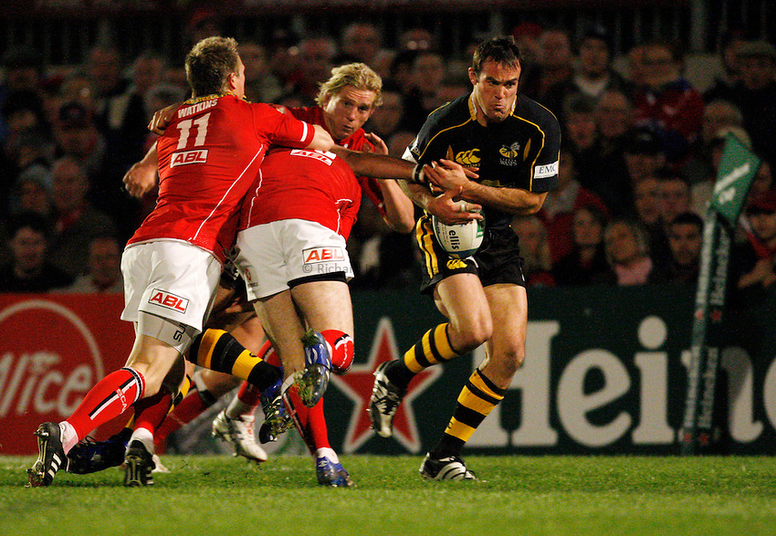 Photo: Richard Lane/Richard Lane Photography..Llanelli Scarlets v London Wasps. Heineken Cup. 17/11/2007. .Wasps' Fraser Waters takes the ball from Tom Voyce to go in for a try.