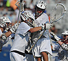 Sam Lucchesi #21, Garden City goalie, second from left, and teammates celebrate after their 7-5 win over Manhasset in the Nassau County varsity boys lacrosse Class B final at Hofstra University on Tuesday, May 31, 2016. Lucchesi held Manhasset scoreless in the fourth quarter to allow the Trojans to rally from a 5-1 deficit and claim the county championship.