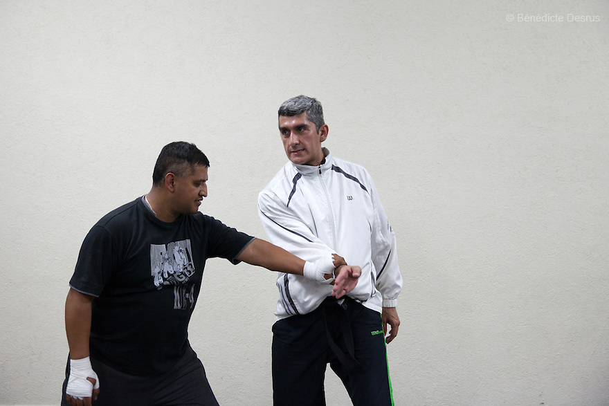 """Donovan leads a self-defense class, which he teaches three times per week, in Texcoco, Mexico on May 21, 2015. He says that the experience of teaching these classes brings him a sense of calm and order that balances out his work as a forensic cleaner. Donovan Tavera, 43, is the director of """"Limpieza Forense México"""", the country's first and so far the only government-accredited forensic cleaning company. Since 2000, Tavera, a self-taught forensic technician, and his family have offered services to clean up homicides, unattended death, suicides, the homes of compulsive hoarders and houses destroyed by fire or flooding. Despite rising violence that has left 70,000 people dead and 23,000 disappeared since 2006, Mexico has only one certified forensic cleaner. As a consequence, the biological hazards associated with crime scenes are going unchecked all around the country. Photo by Bénédicte Desrus"""