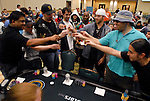 Players at a table, including Victor Ramdin, left, do a shot of tequila during the final level.