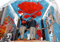 Joseph Charlow checks his phone as he and fellow Clemson University freshman Lawrence Dossche work on the homecoming float for Sigma Chi fraternity Thursday on Bowman Field. Members of several student organizations have been working for the past week to complete their floats in time for the judging on Saturday. This year's homecoming festivities also include the display of the half-scale traveling replica of the Vietnam Veterans War Memorial on Bowman Field. Visitors can view the wall at any time through the weekend. Tigerama, the annual pep rally, will take place in Littlejohn Coliseum at 7 p.m. tonight and will include music, skits fireworks and the crowning of Miss Homecoming. Finally, the Clemson football team will take on Duke at noon on Saturday in Memorial Stadium.