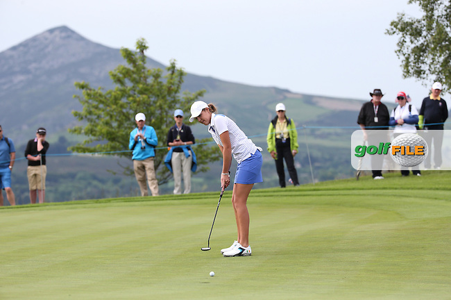 The Sugar Loaf plays a stunning backdrop on hole 4 as Meghan MacLaren putts to win the hole during Friday Foursomes at the 2016 Curtis Cup, played at Dun Laoghaire GC, Enniskerry, Co Wicklow, Ireland. 10/06/2016. Picture: David Lloyd | Golffile. <br /> <br /> All photo usage must display a mandatory copyright credit to &copy; Golffile | David Lloyd.