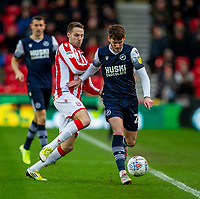 11th January 2020; Bet365 Stadium, Stoke, Staffordshire, England; English Championship Football, Stoke City versus Milwall FC; Nick Powell of Stoke City tackles Jason McCarthy of Millwall - Strictly Editorial Use Only. No use with unauthorized audio, video, data, fixture lists, club/league logos or 'live' services. Online in-match use limited to 120 images, no video emulation. No use in betting, games or single club/league/player publications