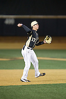 Wake Forest Demon Deacons shortstop Bruce Steel (17) makes a throw to first base against the Delaware Blue Hens at Wake Forest Baseball Park on February 13, 2015 in Winston-Salem, North Carolina.  The Demon Deacons defeated the Blue Hens 3-2.  (Brian Westerholt/Four Seam Images)