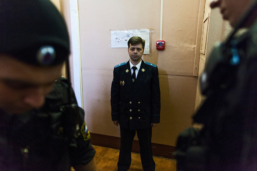 17/08/2012, Moscow, Russia..A prison officer surrounded by special forces police outside the courtroom as Maria Alyokhina, Yekaterina Samutsevich and Nadezhda Tolokonnikova of punk band Pussy Riot are sentenced to two years in prison for their performance in the Christ The Saviour Cathedral.