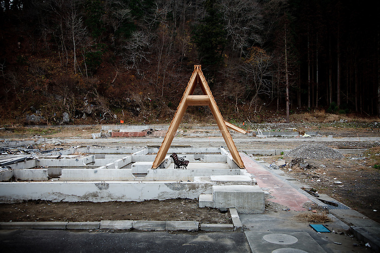 Kamaishi, December 6 2011 - Gassho by KOJI KAKIUCHI and YAOMITSU DESIGNING DEPARTMENT, a wooden structure for people to gather, built on the ruins of a house devastated by the tsunami.