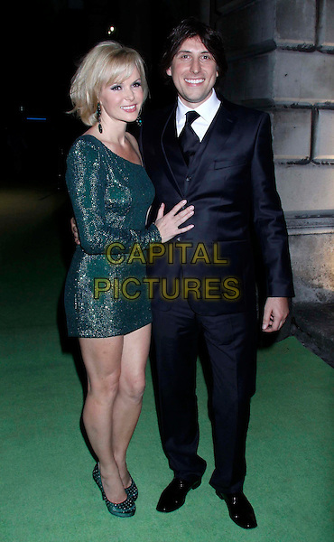 "Amanda Holden & Chris Hughes .At the After Party for ""Shrek The Musical"" Press Night, Somerset House, London, England, UK, June 14th 2011..full length green one shoulder sleeve sparkly dress shoes mini arm around  couple husband wife suit tie black grey gray white shirt .CAP/COA/CC.©CC/COA/Capital ."