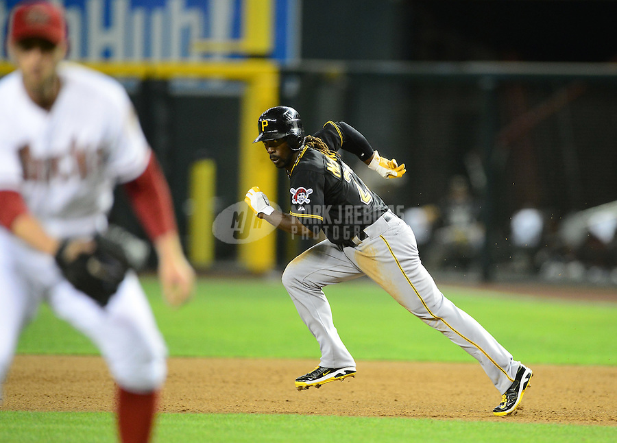 Apr. 17, 2012; Phoenix, AZ, USA; Pittsburgh Pirates outfielder Andrew McCutchen runs to second base in the eighth inning against the Arizona Diamondbacks at Chase Field. The Pirates defeated the Diamondbacks 5-4. Mandatory Credit: Mark J. Rebilas-