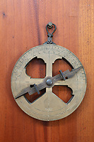 Mariner's astrolabe, 1587, used for calculating latitude and navigating at sea, found in 1845 on Valentia Island, Ireland, where 3 ships of the Spanish Armada were wrecked in 1588, in the museum, or Museo de la Isabela, in the Parque Nacional Historico y Arqueologico de La Isabela, or Historical National Park of La Isabela, one of the oldest European settlements in the New World, in Luperon province, on the North coast of the Dominican Republic, in the Caribbean. The town of La Isabela was founded in 1493 by Christopher Columbus and a fort, houses, church, warehouses, and an arsenal were built, but the settlement was abandoned in 1496 due to hurricane damage. Picture by Manuel Cohen