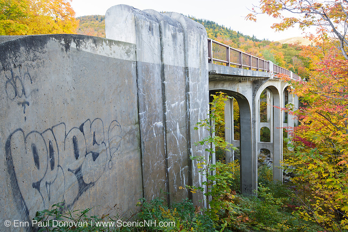 Franconia Notch State Park - The old U.S. Route 3 bridge which crosses over Lafayette Brook in the White Mountains, New Hampshire USA during the autumn months. This bridge is closed to traffic and is part of the multi-use Franconia Notch Bike Path.