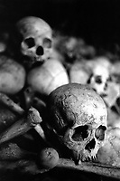 An execution ground where the bones of victims are piled up. Nearly 2 million people died under the Khmer Rouge through overwork, starvation or execution.