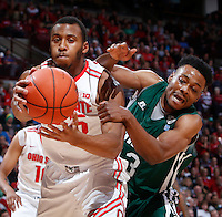 Ohio State Buckeyes center Trey McDonald (55) is guarded by Ohio Bobcats guard/forward T.J. Hall (13) during Tuesday's NCAA Division I basketball game at Value City Arena in Columbus on November 12, 2013. (Barbara J. Perenic/The Columbus Dispatch)