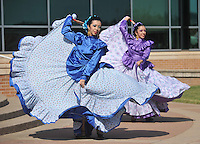 NWA Democrat-Gazette/MICHAEL WOODS • @NWAMICHAELW<br /> Brenda Hernandez (from left) and Kayla Hernandez with the Latin Art Organization of Arkansas, perform a dance Saturday September 26, 2015 during the Peace at Home Family Shelter's 12th Annual Fiesta at the Jones Center in Springdale.  The event was held in collaboration with the NWA Center for Sexual Assault, NWA Women's Shelter, and The Children's Safety Center of Springdale. The purpose of this event was to bring awareness about domestic violence, child abuse, sexual assault, and available resources to our local Spanish-speaking community. The free event had food, door prizes, music, Zumba, and more than 25 local service providers and businesses tabling the event.