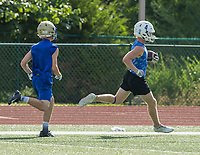 NWA Democrat-Gazette/BEN GOFF @NWABENGOFF<br /> Elijah Bigham, Rogers slot reciever, runs after a catch vs Harrison Thursday, July 11, 2019, during the Border Battle 7-on-7 Tournament, in partnership with the Pro Football Hall of Fame Scholastic 7v7 series, at Branson (Mo.) High School's Pirates Stadium.